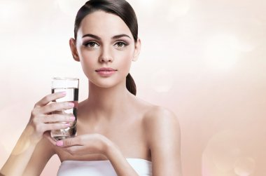 Young beautiful lady with glass of clear water, healthy life concept