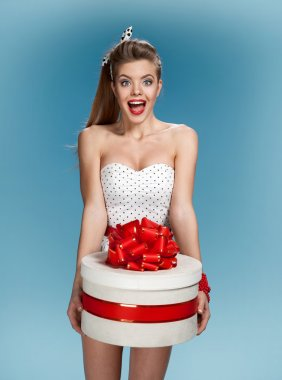 Happy surprising pin up girl take a gift