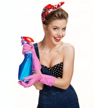 Smiling cleaning woman wearing pink rubber protective gloves holding blue spray