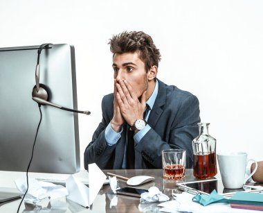 Businessman looking at computer screen with horror