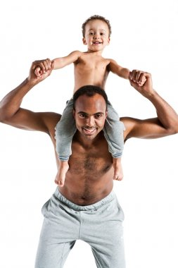 Young father with son on shoulders, carefree and happy