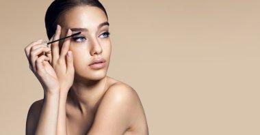Mascara applying. Makeup closeup. Eyes make-up