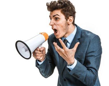Stressed man yelling through a megaphone