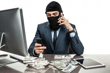 Masked anonymous businessman wearing balaclava helmet