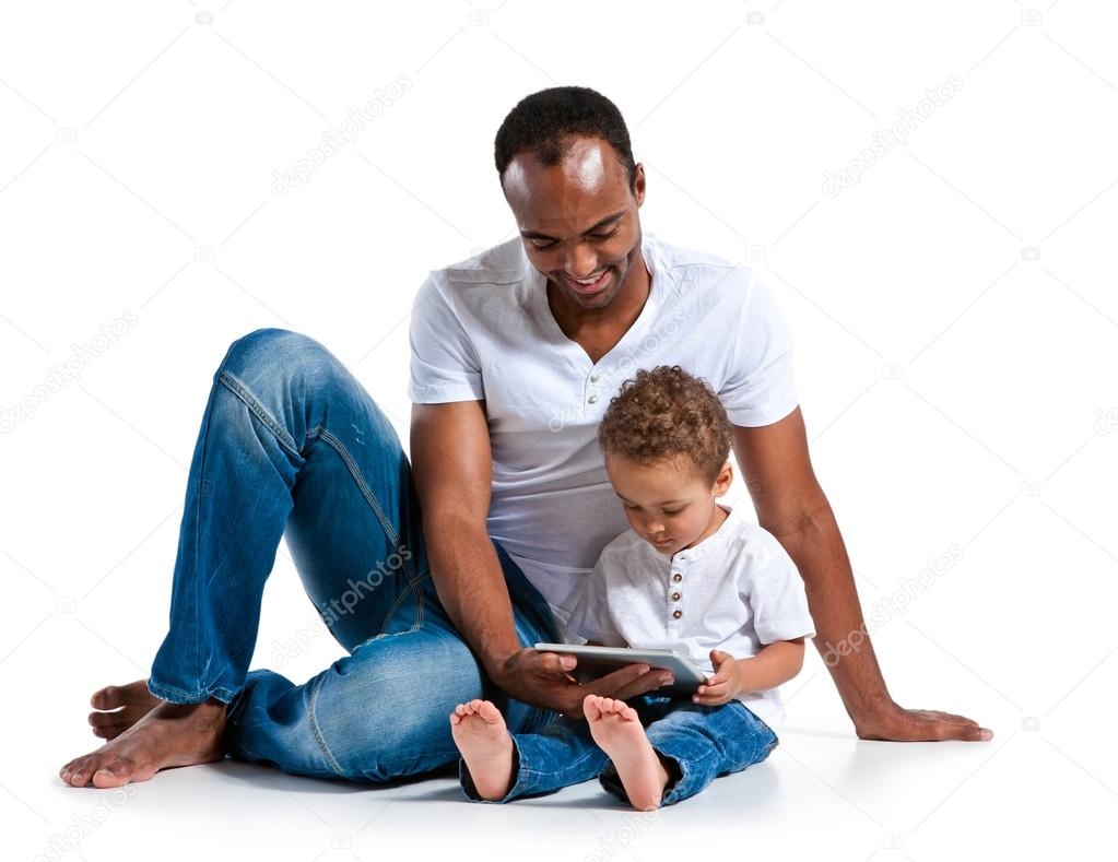 Happy father with his son looking at touch-pad PC. Learning and early education concept