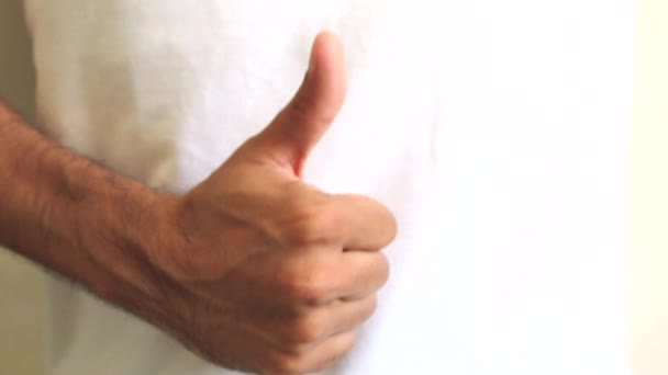 Hand giving thumbs down and up