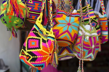Wayuu handcrafted mochilas bags for sale in Guatape market, Colo