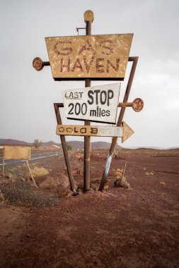 abandoned gas sign  in the desert