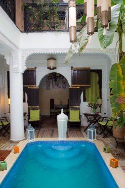 Classical Moroccan riad interior with traditional swimming pool