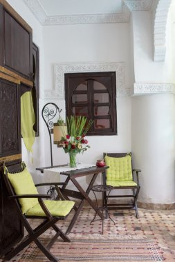 Classical Moroccan riad interior with traditional furnitures