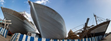 Wooden fishing boats under construction in shipyard, Morocco