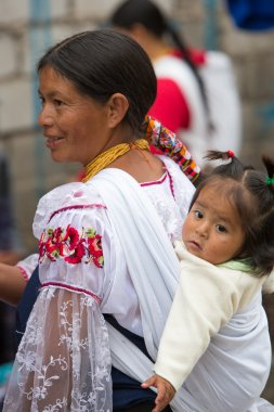 Woman and daughter at the Otavalo market, Ecuador