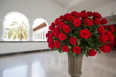 Set of red roses arranged in a stone vase. Quito
