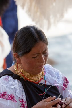 Woman at work at the Otavalo Market, Ecuador
