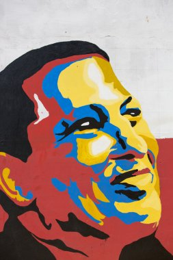 Colourful design of Hugo Chavez on a wall in Pampatar, Venezuela