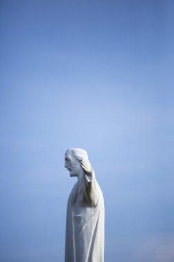 Cristo del Rey statue of Cali with blue sky, Colombia