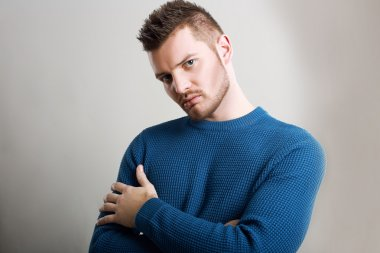 Man wearing blue sweater
