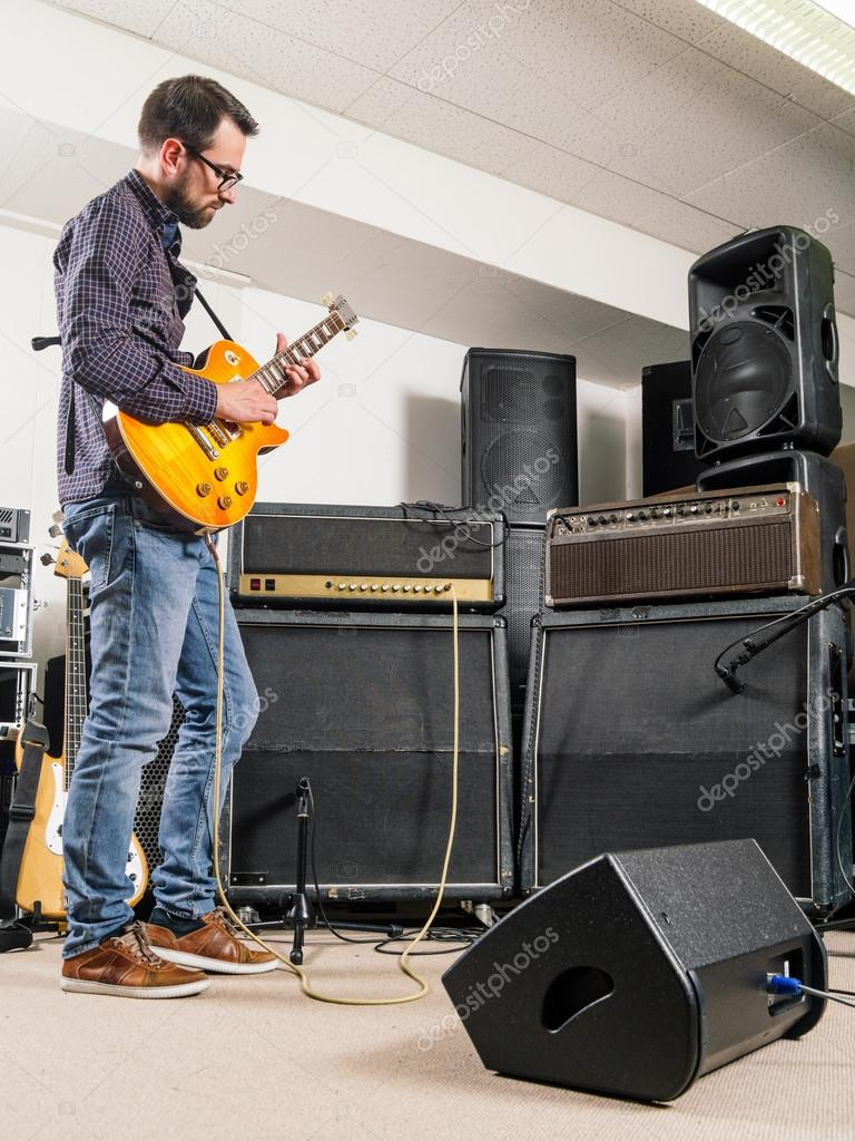 Playing Electric Guitar In A Jam Room Stock Photo Sumners 117040560