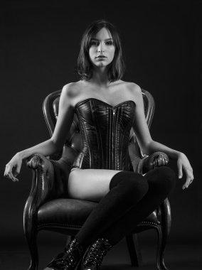 Beautiful woman sitting wearing a corset