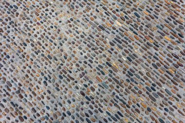 Seamless tile background made of small stones
