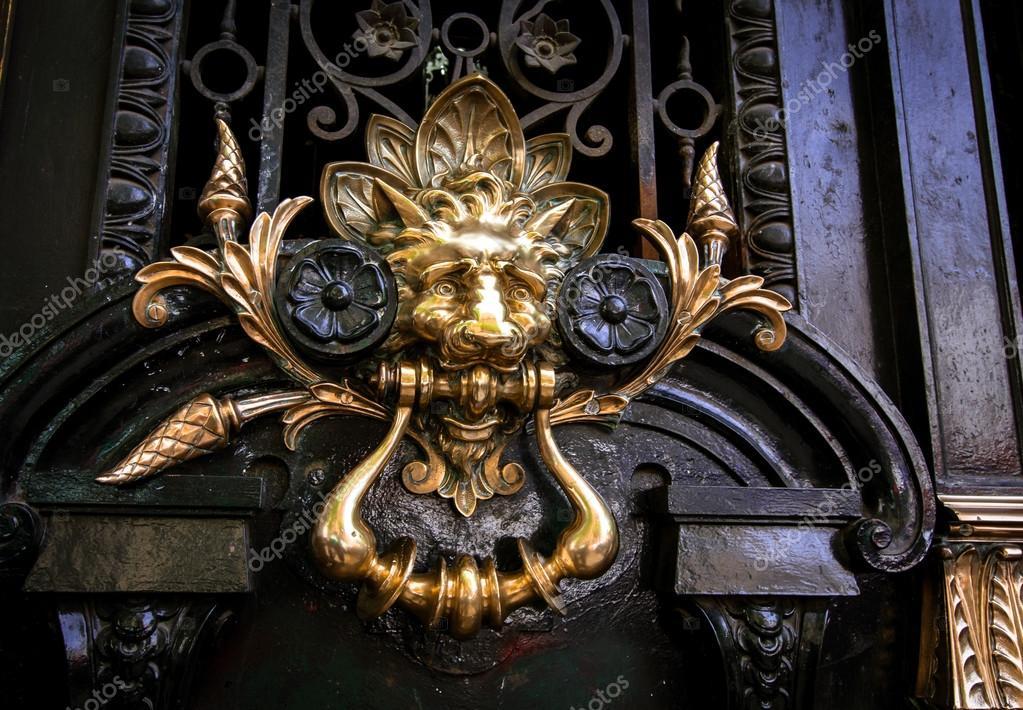 A lion door knocker on a door in Argentina u2014 Photo by rusty426 & decorative lion door handle u2014 Stock Photo © rusty426 #114008818