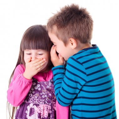Little boy and girl whispering