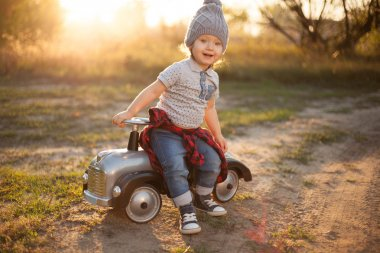 Toddler playing with toy car outdoors
