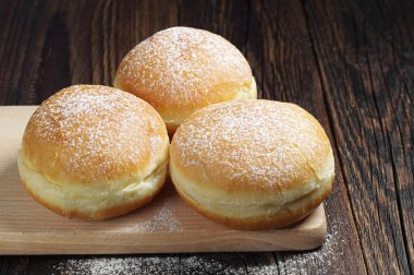 Traditional doughnuts with powdered sugar
