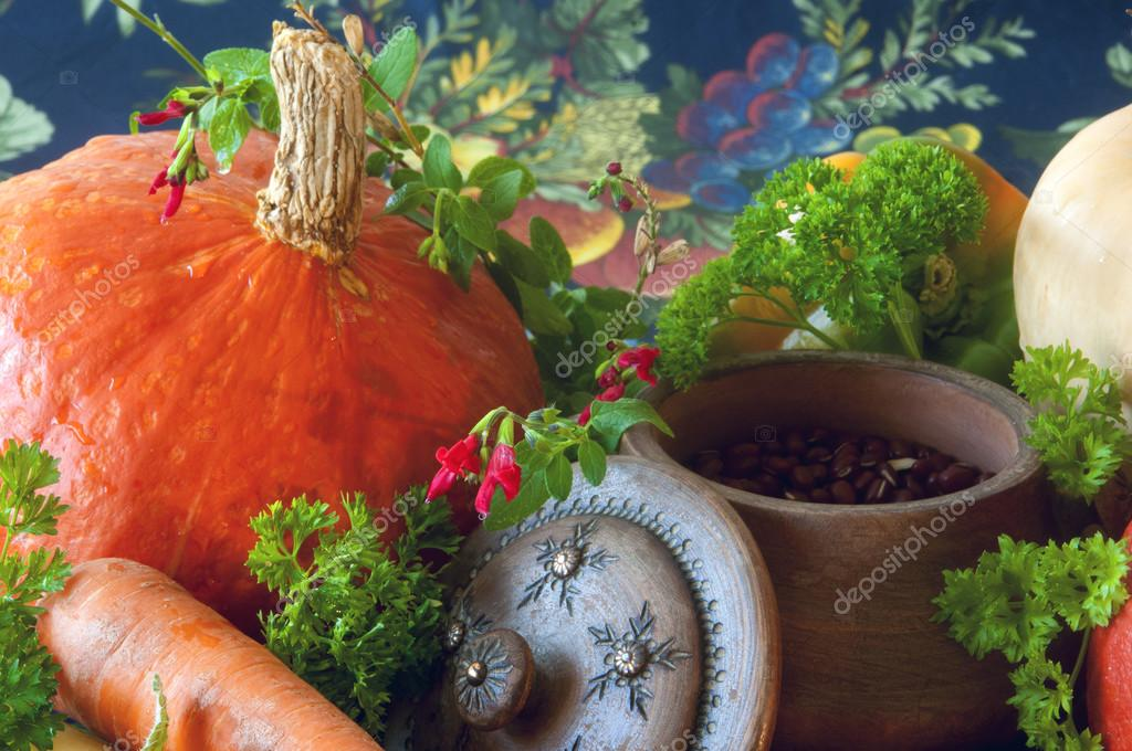 Pumpkins, carrots, seeds, butternut squash and herbs - Still life composition with seasonal vegetables of autumn