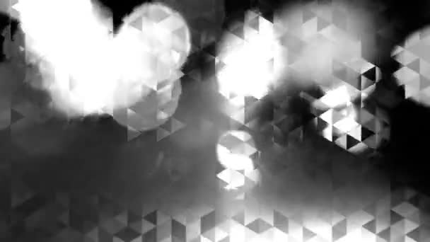 graphic black and white animation with triangles and flashes of light in bokeh - Full HD