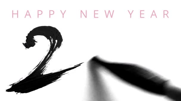 Writing 2016 with a chinese brush and thick ink - live calligraphy for the new year - greeting video card in english with text on the top.