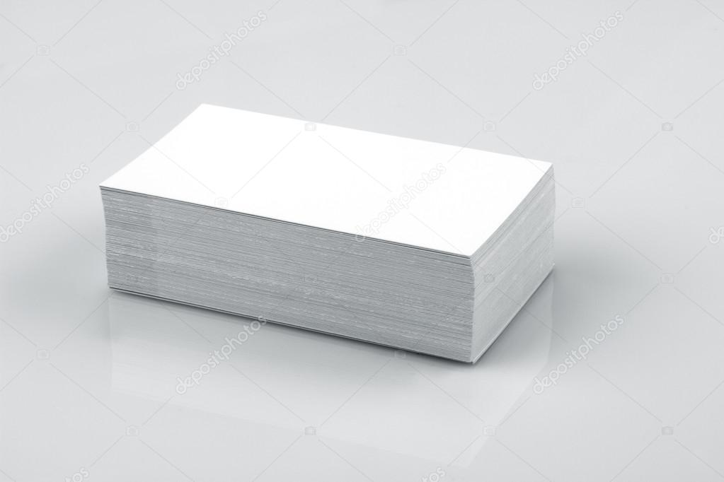 Blank business card mockup on white reflective background stock blank business card mockup on white reflective background photo by akhilesh reheart Choice Image