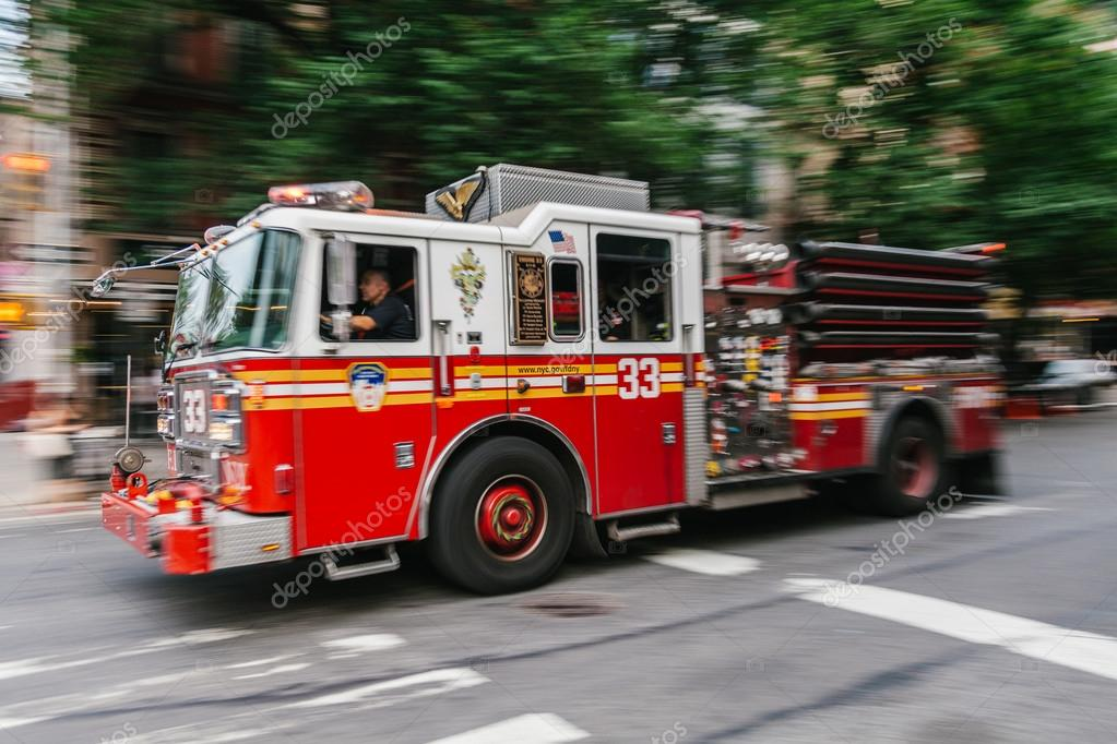 Firefighter truck on Manhattan streets. FDNY provide both Fire a