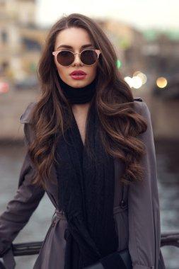 Glamorous girl wearing stylish coat