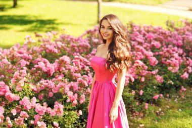 Smiling woman portrait in pink roses