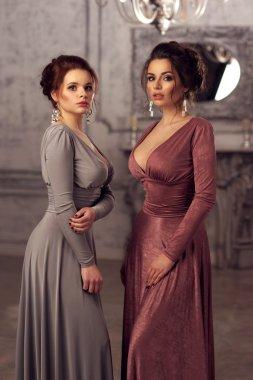 two ladies in dresses