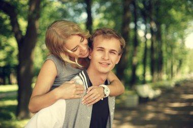 lovely couple hugging in summer park