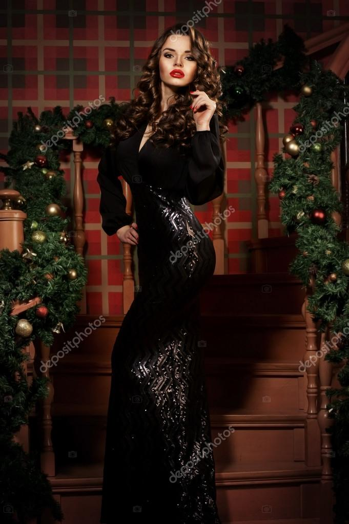 Beautiful sexy girl in elegant black dress in festive decorated interior  with christmas tree. Fashion style portrait — Fotó szerzőtől Dmitry Tsvetkov f38d5ab63d