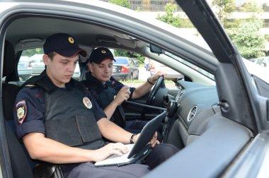 Police in the patrol car.