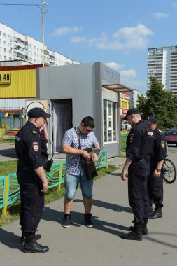 Police officers inspect the documents on the streets of Moscow.