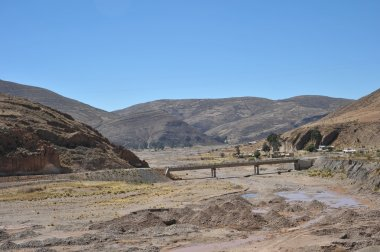 The bridge over the mountain river in the Altiplano