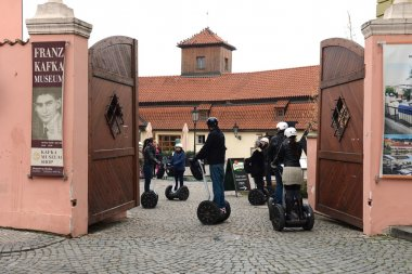 Tourists on Segways in the Museum of Kafka.