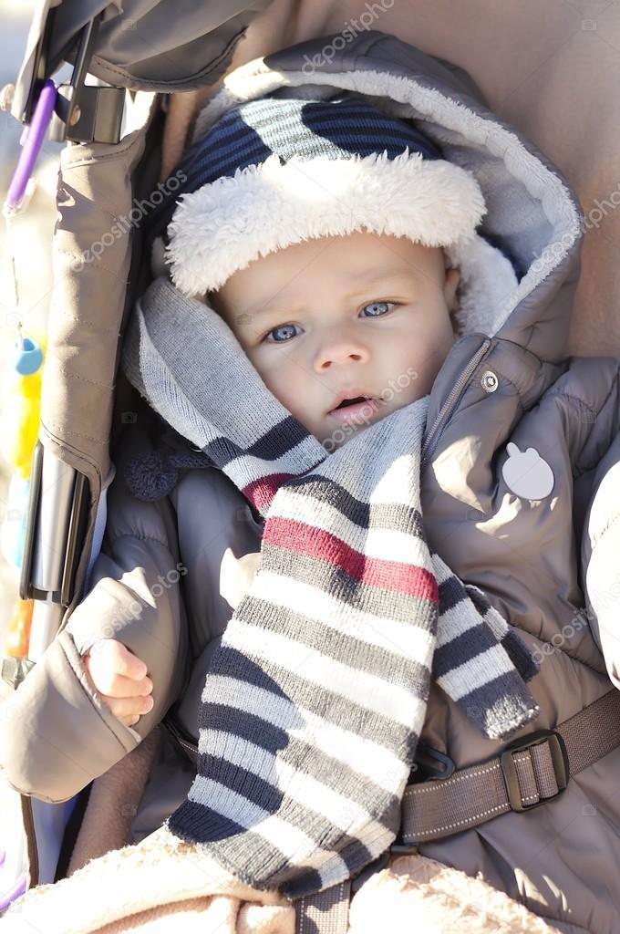 Portrait of cute little baby boy wearing warm winter hat ...