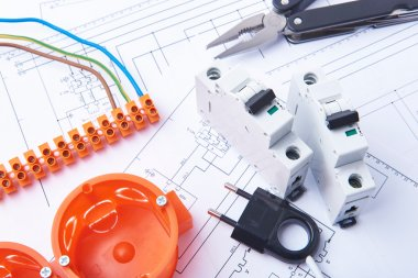 Components for use in electrical installations. Fuses, plug, connectors, junction box, switch, isolation tape and wires. Accessories for engineering work.