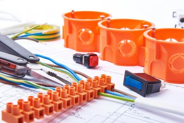 Components for use in electrical installations. Connectors, junction box, switch, isolation tape and wires. Accessories for engineering work, energy concept.