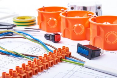 Components for use in electrical installations. Fuses, connectors, junction box, switch, isolation tape and wires. Accessories for engineering work, energy concept.