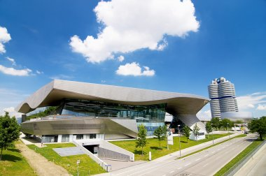 BMW house in Munich is located next to the headquarter of a company and the museum of BMW.