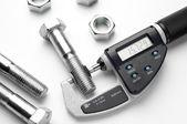 Fotografie Digital micrometer with adjustable pressure measurement with steel screw.