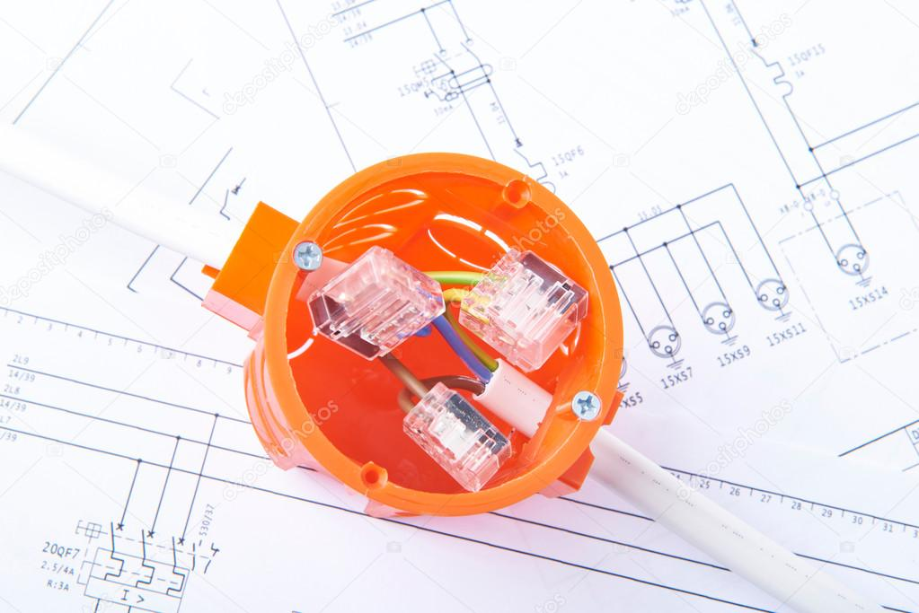 cable connections in electrical junction box lying on electrical diagrams  concept of energy works 98989936