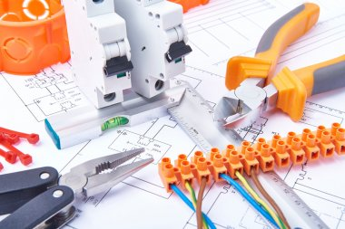 Components for use in electrical installations. Pliers, connectors, fuses, plug and wires. Accessories for engineering work, energy concept.